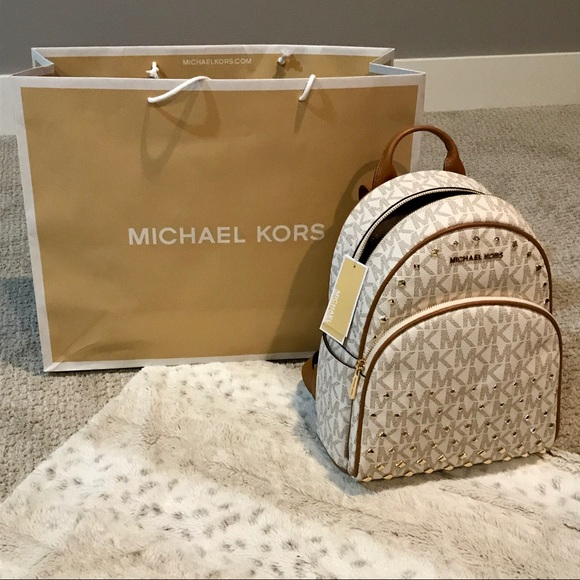 7a7fbe297fc4 Michael Kors Bags | Firm Studded Abbey Medium Backpack In White Mk ...